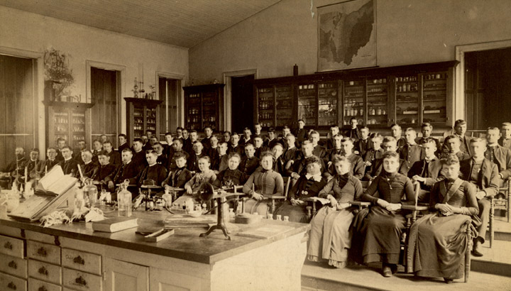 Students at a dentistry class pose for a photo