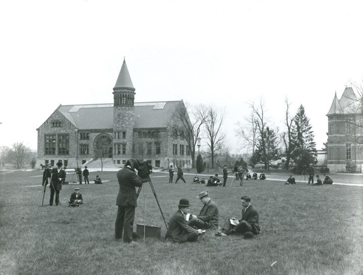 Students take pictures of buildings on the oval for a photography class