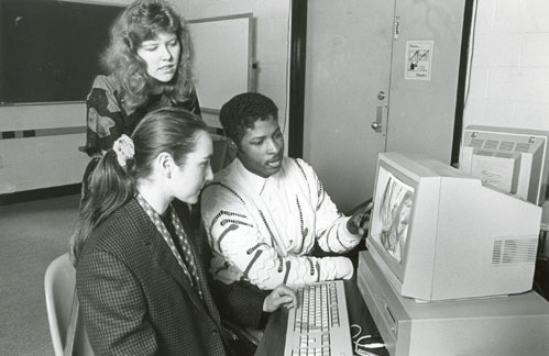 Students look at a computer screen during class