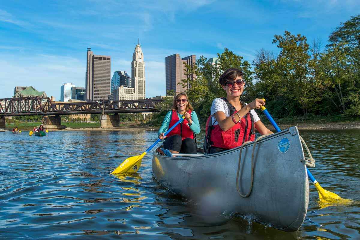 Students kayak on a river