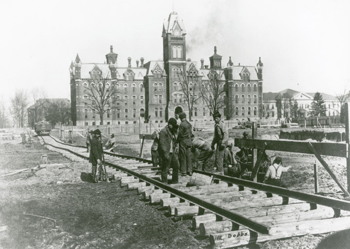 Students build a railway on the oval in 1911