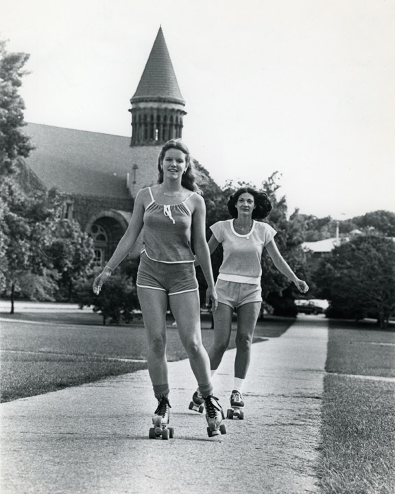 Student rollerskate on the oval