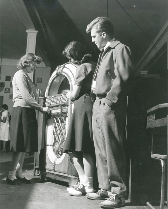 Students stand next to a jukebox