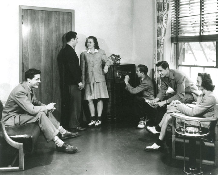 Students lounge in a dorm room in 1939